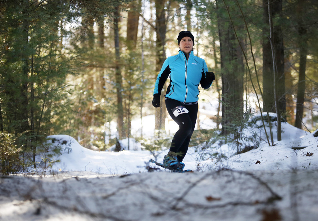 Kristen Okerholm traverses a trail through the woods during the 5k race. Derek Davis/Staff Photographer