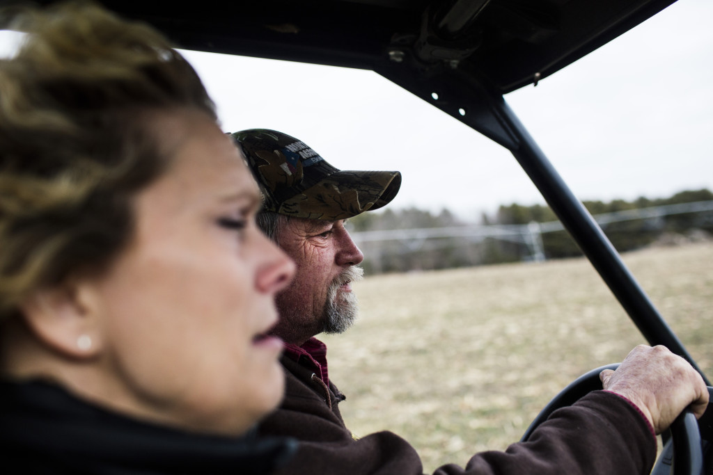 Rick Grant drives with Stacy Grant along their farm, Grant's Farm, in Saco. Whitney Hayward/Staff Photographer