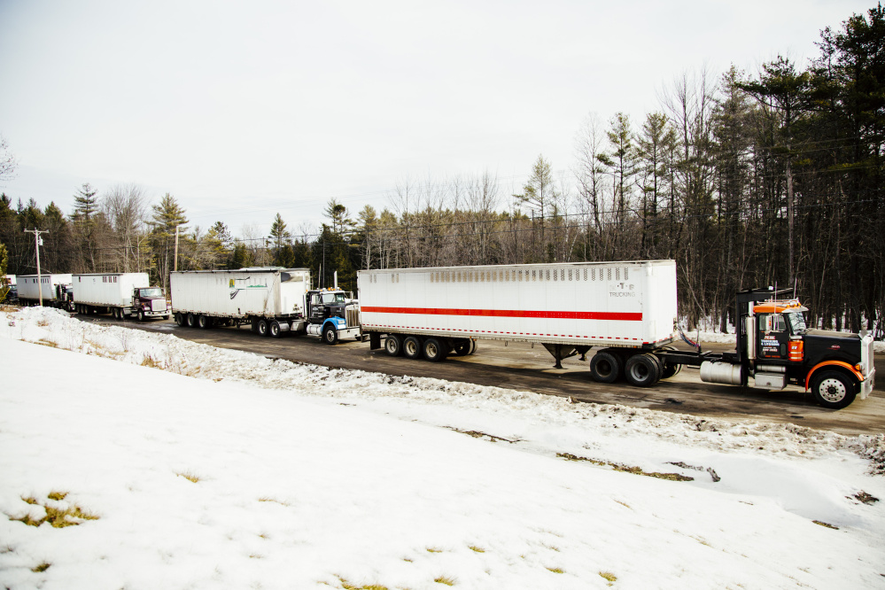 LIVERMORE FALLS, ME - JANUARY 26:  A line of semi trucks carrying wood biomass fuel outside the ReEnergy biomass plant in Livermore Falls, ME on Tuesday, January 26, 2016. Photo by Whitney Hayward/Staff Photographer)
