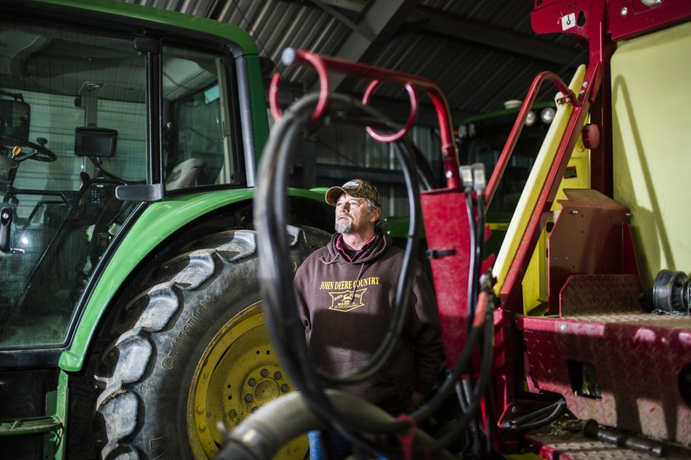 Rick Grant in their machine barn on his farm, Grant's Farm, in Saco,. Whitney Hayward/Staff Photographer