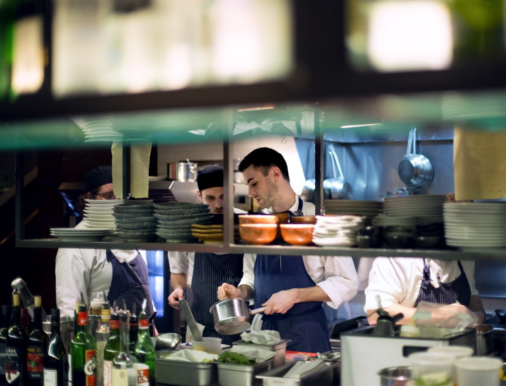 Matthew Ginn, the chef at Evo, works with his team at the restaurant. Ginn spent 10 years focusing on French fine dining and tasting menus in Portland and Boston before switching to eastern Mediterranean food and small plates.