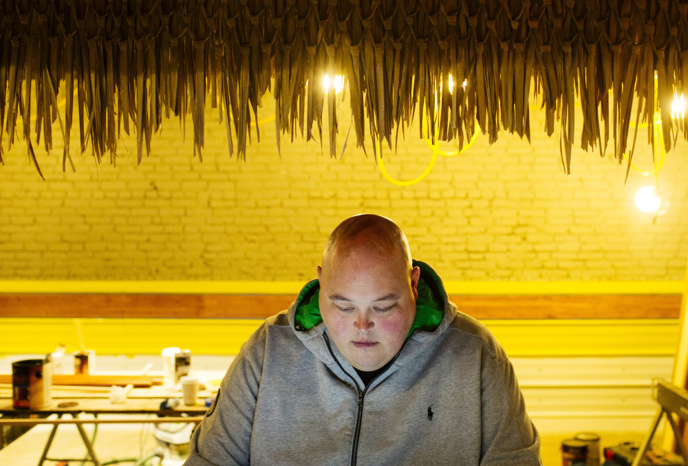 Jason Loring, 39, a force behind some of the city's hottest restaurants, works at his new tiki lounge, Rhum.