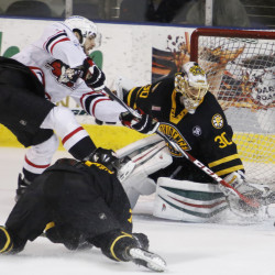 Wade Megan, left, of the Pirates tries unsuccessfully to slip the puck past Providence Bruins goalie Jeremy Smith during the third period Friday night at Cross Insurance Arena. The Pirates won, 2-0.