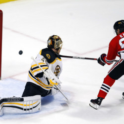 The Associated Press Chicago's Patrick Kane scores past Boston's Tuukka Rask during the Blackhawks 6-4 win Saturday in Chicago. Kane finished with three goals and an assist.