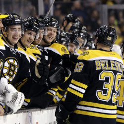 The Bruins' bench greets Bruins defenseman Torey Krug, 47, and left wing Matt Beleskey after Krug's goal against the Detroit Red Wings in the second period Thursday night in Boston. The Bruins won 5-2.
