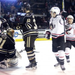 Kyle Rau, center, celebrates after giving the Portland Pirates an early lead in the first period of their 6-4 win over Hershey on Friday at Cross Insurance Arena. Portland leads the best-of-five series 1-0.