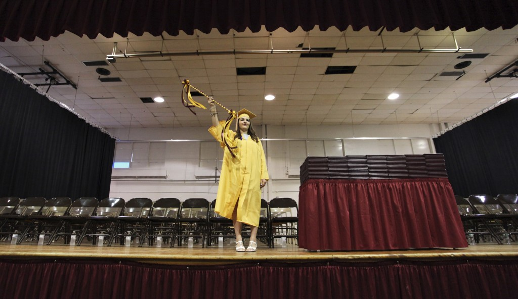 SACO, ME - JUNE 5: Senior class president Sarah Picard moves the baton during the processional at Thornton Academy graduation.(Photo by Jill Brady/Staff Photographer)