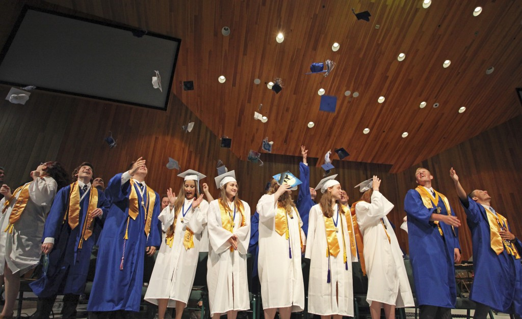 OLD ORCHARD BEACH, ME - JUNE 5: Graduates toss their caps in the air at the conclusion of Old Orchard Beach High School graduation. Jill Brady/Staff Photographer