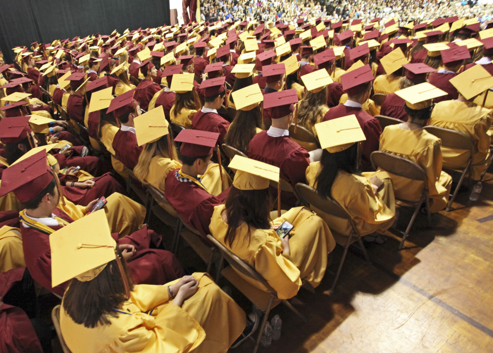 Linnell Gymnasium is a sea of maroon and gold at Thornton Academy's graduation in Saco on Sunday.