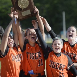 Biddeford players, from left, Erin Martin, Jocelyn Moody, Cassie Gonneville and Charlotte White celebrate winning the Class A South title on Tuesday. Next up: Saturday's state championship clash with Skowhegan.