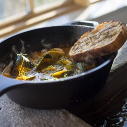 Fish and shellfish stew, with fresh squid, tomato fennel broth and grilled bread.