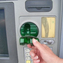 Thieves placed the skimmer's fake card reader slot over the actual slot.