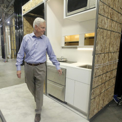 David Hall checks out a kitchen for a new type of modular residential structure Friday at a warehouse in Provo, Utah. Hall, a Mormon businessman, has an ambitious plan to create communities in Utah and Vermont of small, environmentally sustainable dwellings based on the teachings of church founder Joseph Smith.