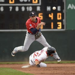 New Hampshire's Jason Leblebijian attempts to turn a double play as Cole Sturgeon of the Portland Sea Dogs slides into second base to break up the play during Wednesday's game at Hadlock Field. The Sea Dogs won, 10-7.