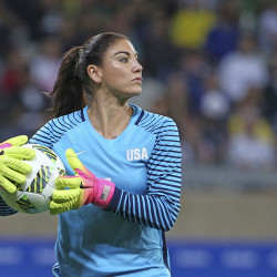 """U.S. goalkeeper Hope Solo takes the ball during a match against New Zealand in Belo Horizonte, Brazil., on Aug. 3. U.S. Soccer says her comments about Sweden's team were """"unacceptable and do not meet the standard of conduct we require from our National Team players."""" Eugenio Savio/Associated Press"""