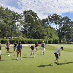 """Members of the Cape Elizabeth golf team work on their putting at Purpoodock Golf Club's practice green one recent morning. Purpoodock tries to give plenty of access to junior players – the club's """"future members."""""""