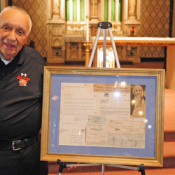 Ralph Ardito Sr. stands Friday with a framed thank-you letter from Mother Teresa at St. Mary's Church in Augusta. The soon-to-be saint wrote to Augusta's Knights of Columbus group in 1978 to thank it for a $1,000 donation.