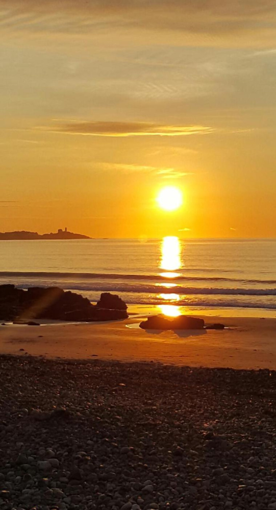 It's the dawning of another day at York's Long Sands Beach, where the water is still OK for swimming for the hardier types. By Yvonne Migneault of Acton.