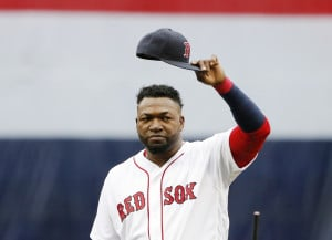 David Ortiz of the Boston Red Sox tips his hat to the crowd Sunday during an emotional ceremony prior to his final regular-season game at Fenway Park. The Red Sox also announced that Ortiz's number will be retired next season.