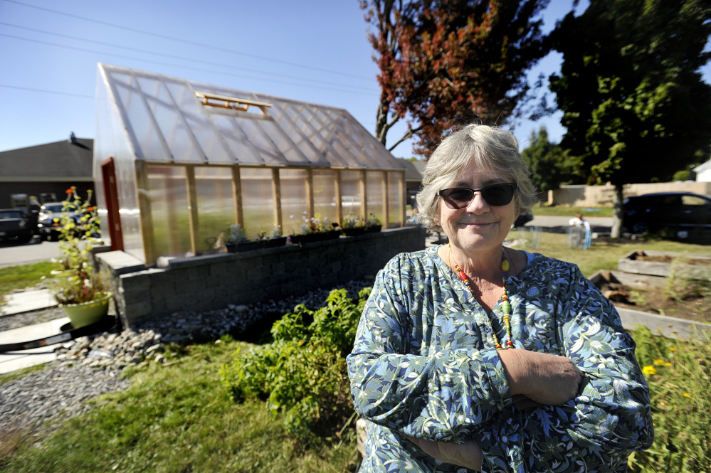 Teacher Guyla Woodbrey near the greenhouse in the garden at Saccarappa School in Westbrook. Shawn Patrick Ouellette/Staff Photographer