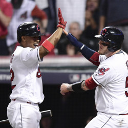 Cleveland's Roberto Perez, right, celebrates with Francisco Lindor after scoring on a Jason Kipnis single against the Boston Red Sox in the fifth inning Thursday night in Cleveland. Associated Press/David Dermer