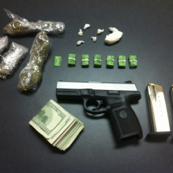 The loaded handgun above was among the items seized by Maine DEA agents, working with Westbrook and Portland police, when they investigated a tip about drug trafficking in Portland in 2011.