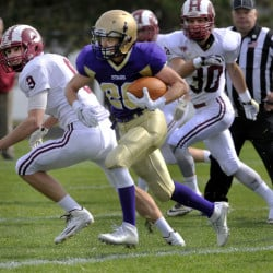 Cheverus running back Max Coffin breaks into the Bangor secondary for a big gain Saturday at Boulos Stadium. Coffin rushed for 141 yards and a touchdown in a 30-0 victory.