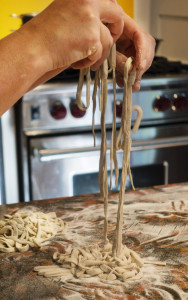Christine Burns Rudalevige prepares Asian noodles, far left, with flour she was trying to use up from her cupboard. The beauty of DIY noodles, she says, is that to make them, you need only flour, hot water and a rolling pin. Carl D. Walsh/Staff Photographer