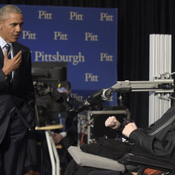 "President Obama talks with Nathan Copeland, right, in Pittsburgh on Thursday. ""What a story,"" Obama said after shaking and fist-bumping Copeland's prosthetic hand."