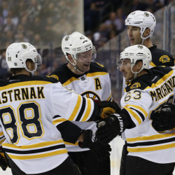Brad Marchand, front right, celebrates his goal against Columbus with David Pastrnak, David Backes and Zdeno Chara in the third period Thursday night.