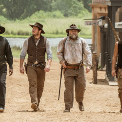 "Denzel Washington, left, and Martin Sensmeier, right, with Chris Pratt and Vincent D'Onofrio, converse in Commanche in ""The Magnificent Seven."""