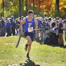 Falmouth High's Jeremiah Sands approaches the finish line as the winner of the boys' race at the Western Maine Conference Cross Country Championships Friday at St. Joseph's College in Standish. (Photo by John Ewing/Staff Photographer)
