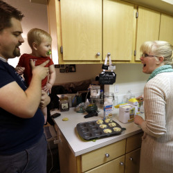 "Shavonne Henry greets her 7-month-old son, Jordan, as her husband brings him into the kitchen. Unlike many of their peers, the Vancouver, Wash., couple in their mid-20s have savings in 401(k) accounts. ""I feel pretty good about our future,"" said Shavonne."