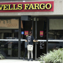 Wells Fargo says bank visits are down and consumer checking account openings dropped 25 percent in September from a year earlier and they were down 30 percent from August.