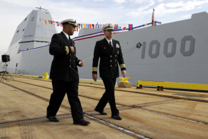 Lt. Rick Moore, left, and Capt. James Kirk, commanding officer of the future USS Zumwalt, walk past the ship to a news conference on Thursday in Baltimore.