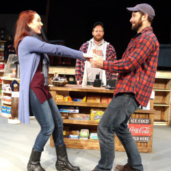 "Mary Mossberg and Augustus Kelley star as Lurene Legasse Soloway and Nat Paradis in ""Last Gas."" Ben Loving, in the background, plays Guy Gagnon. Photo courtesy of Public Theatre"