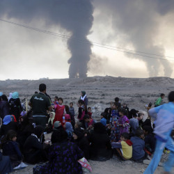 Smoke rises as people flee their homes during clashes between Iraqi and Islamic State forces near Mosul, Iraq, on Tuesday. Capturing the city represents a critical showdown for the Iraqis.