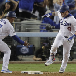 The Dodgers' Yasmani Grandal celebrates after hitting a two-run home run in the fourth inning of Game 3 of the National League Championship Series on Tuesday night in Los Angeles.