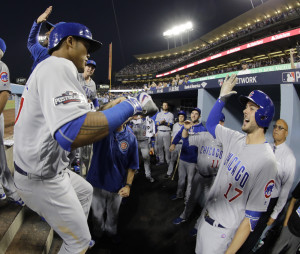 Addison Russell of the Cubs is congratulated after hitting a two-run home run in the fourth inning of Game 4 of the NLCS Wednesday night in Los Angeles.