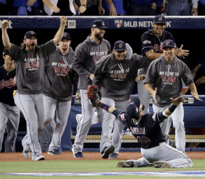 Indians first baseman Carlos Santana celebrates after making the final out in Cleveland's series-clinching 3-0 win over Toronto in the American League Championship Series. Four months after the NBA's Cavaliers won a title, the Indians are poised to give the city another.