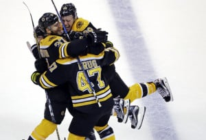 Patrice Bergeron, 37, celebrates his goal with David Pastrnak, 88, and defenseman Torey Krug in the third period Thursday night in Boston.