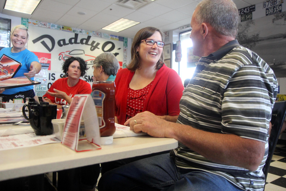 Democrat Emily Cain, who is running for the U.S. House in Maine's 2nd District, chats with Maine House candidate Mike Twitchell, D-Norway, recently at Daddy O's in Oxford. Cain's forthrightness on issues and potential for advancing Maine causes in Washington has earned her our endorsement.