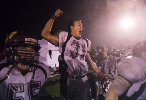 Cape Elizabeth senior Alex Depke celebrates as his team completes an unbeaten regular season with a 13-7 win over Wells.