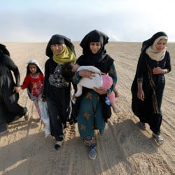 Civilians return to their village south of Mosul, Iraq, after it was liberated from Islamic State militants on Friday.