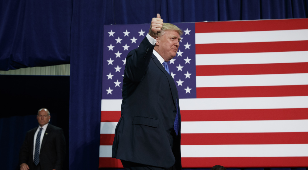 Republican presidential candidate Donald Trump arrives to speak at a campaign rally Friday in Fletcher, N.C.