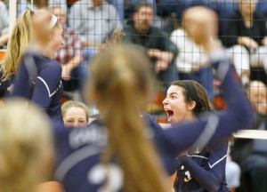 Yarmouth's Marie LeBlanc celebrates with teammates Saturday after the winning point against Biddeford in a Class A volleyball quarterfinal.