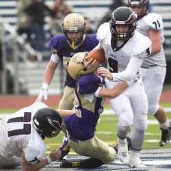 Windham running back Kyle Houser powers through the Cheverus defense in the second half Saturday at Fitzpatrick Stadium in Portland. Windham rallied in the second half for a 13-12 win.