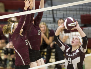 Kayley Cimino of Greely, right, sets the ball as Caralin Mills, left, and Kristen Curley of Gorham jump up to the net to block during Greely's 3-1 victory Saturday in a Class A volleyball quarterfinal. The undefeated Rangers will be home against Falmouth in the semifinals Wednesday.