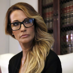Jessica Drake listens during a news conference at the office of her attorney, Gloria Allred, in Los Angeles on Saturday.