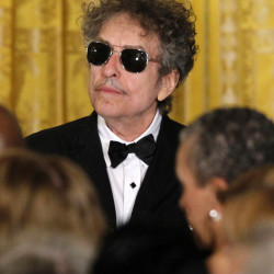 Bob Dylan shouldn't think twice about commenting on his Nobel Prize, a Swedish Academy member says.